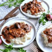 Three plates of mashed potatoes and mushroom burgundy