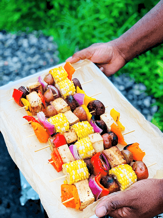 Vegan Kabobs served on tray in front of camp fire