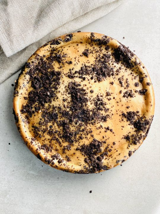 A entire baked oreo crusted vegan gluten free cheesecake