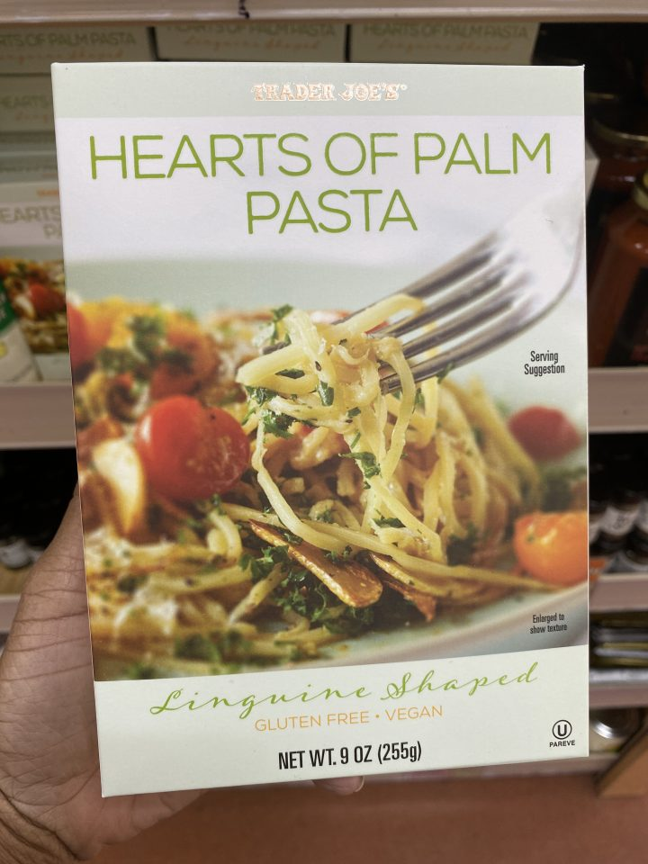 A hand holding a box of Hearts of Palm Pasta