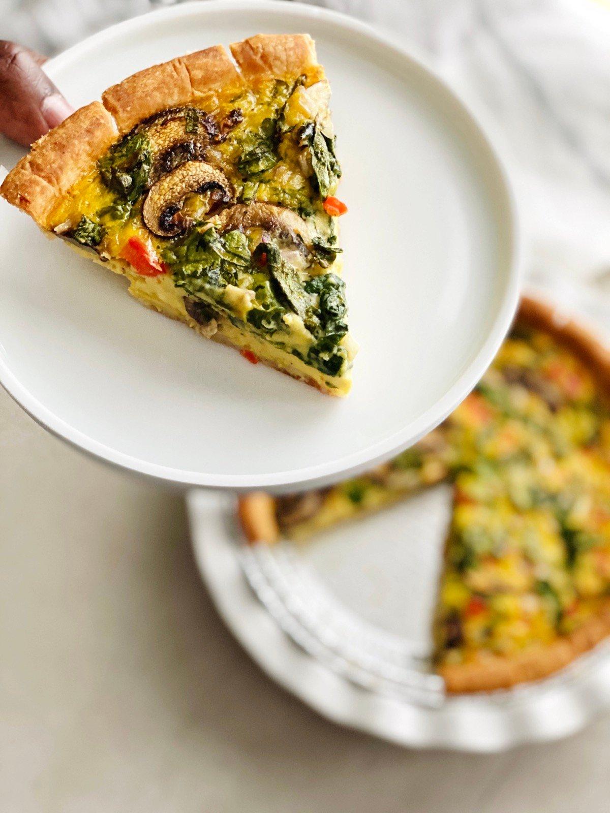 Slice of vegan gluten-free quiche on a plate