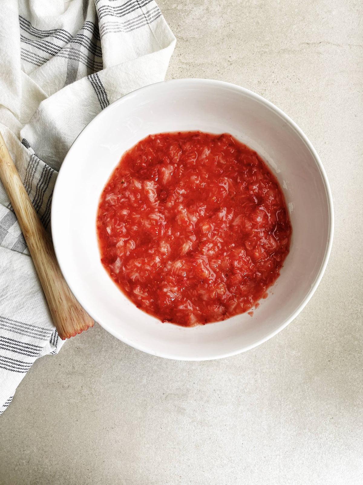 Preparing strawberry for jam